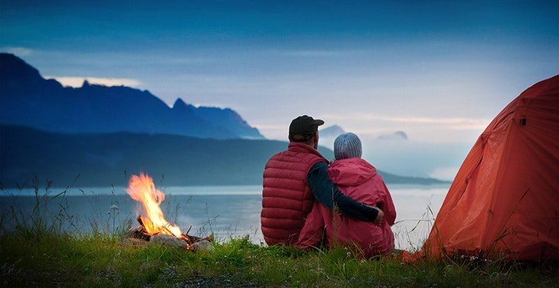 couple-watching-the-sunrise-when-camping