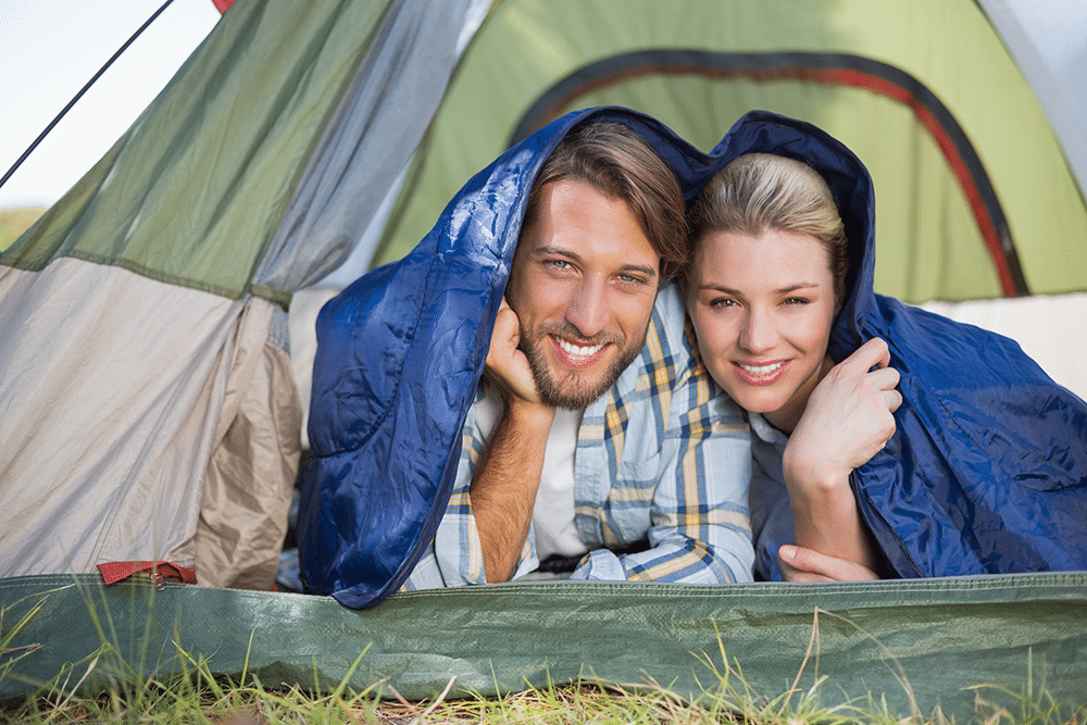 Attractive-couple-lying-in-the-sleeping-bag